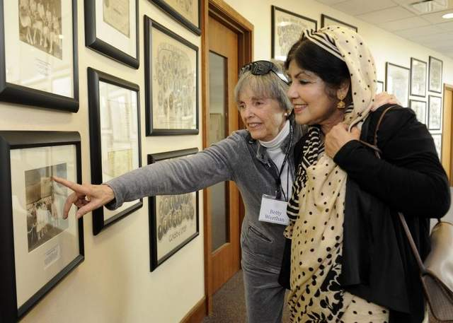 Betty Werthan, from Temple Congregation Ohabai Sholom, shows Ziaun Fakhruddin, from the Islamic Center of Murfreesboro, members of her family during a tour of the Temple on Sunday. / Sanford Myers / The Tennessean