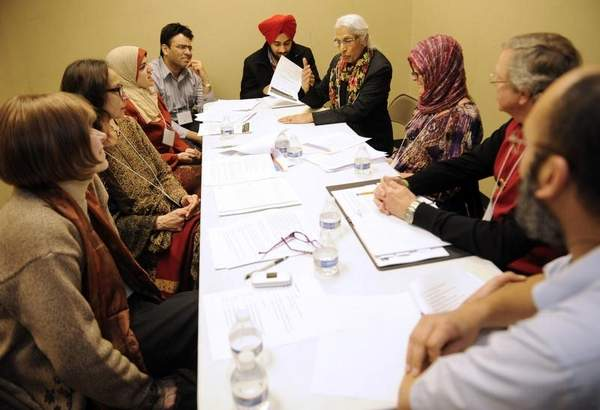 The scripture dialogue circle with St. Paul's Episcopal, the Islamic Center of Williamson County and Nashville Sikh Gurdwara discuss scripture on Sunday at the Islamic Center of Williamson County in Franklin. Sanford Myers / The Tennessean