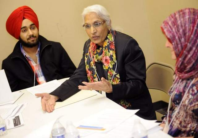 Swarn Kaur Birdee, middle, of the Sikh group, speaks as Lalli Singh, a Sikh, left, and Rhonda Gilmore of the Christian group listen during a meeting of Sikhs, Muslims and Christians at the Islamic Center of Williamson County. / Sanford Myers / The Tennessean
